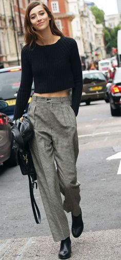 Street style | Long sleeves crop top, grey trousers, leather jacket, handbag