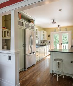 New cased openings, columns and wainscotting celebrate this Craftsman era home. A perch space in the kitchen allows friends to enjoy time in the kitchen while giving the cook plenty of room to cook.