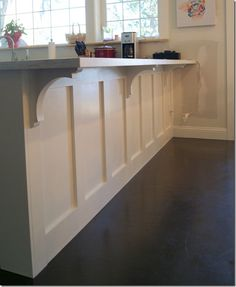 Corbels from home depot. Could do this to the kitchen bar but in navy dark or maroon or golden yellow Kitchen Cabinets Uk, Kitchen Redo, Kitchen Ideas, Kitchen Bar Counter, 10x10 Kitchen, Kitchen Island Corbels, Kitchen Island Panels, Kitchen Island Upgrade, Kitchen Island Finishes