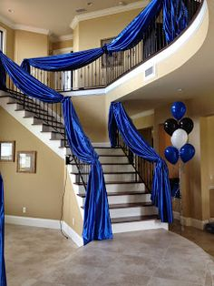 Staircase fabric draping and balloon decor for Graduation Party By Party People Celebration Company