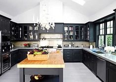 Island is a must for the dream kitchen love the use of the wood in a sleek black kitchen
