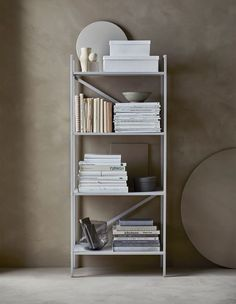 Draget Shelf Unit $29.99 An organized, open shelving unit with storage boxes and books sorted by colours and covered in paper