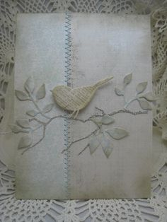 handmade card ... shabby chic style ... patterned paper lightly sponged around the edges ... zig zag sewing down  the center ... branches and leaves die cut from patterned paper ... Memory Box bird die to cut out old book paper ... artistic look ...