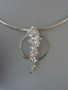 Pendant,silver casted in peas, constructed, Anita Braat-Hopstaken, Passions Jewellery Design