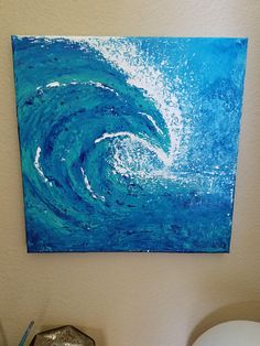 Using mostly blue acrylics and a palette knife, I made this semi-fluid textured wave where green hues blend into the water and white foam/sea spray extends in spots that can be felt on the canvas. This painting is part of my journey into abstract land/seascapes where Ive been