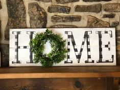 This wood home sign features a beautiful black and white buffalo check pattern in each letter and a dimensional eucalyptus wreath - doesn't get more FARMHOUSE than this!