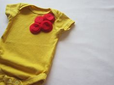 layered flower onesie...possibly rit dyed yellow?