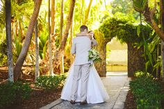 Daniel walked half way down the Villa Botanica pebbled aisle to meet his beautiful bride and escort her to the ceremony pavillion.