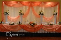 2 panel kit backdrop- white backdrop with peach and coral draping.