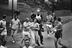 "In 1967 Kathrine Switzer registered for the Boston Marathon as ""K.V. Switzer"" and became the first woman to run with a race number (1966 Roberta Gibb hid in a bush at the start line and ran the race unregistered). Two miles in, Marathon officials attempted to remove her from the race, however her running mates pushed the official off her and she finished the race in 4 hours and 20 minutes. Women were finally allowed to participate in 1972."