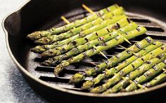 Interesting way of grilling asparagus.  Cook on griddle pan on skewers few mins either side until tender.  Add a squeeze of lemon, drizzle of olive oil plus salt and pepper.