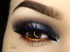 This multi-colored look by Natalia Piotrowicz is called 'Smoky Garden'. She used Makeup Geek Eyeshadows in Bada Bing, Creme Brulee, and Roulette + Makeup Geek Duochrome Eyeshadows in Blacklight, Karma, and Secret Garden.