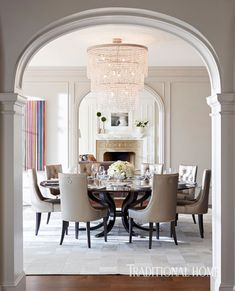 Glimmering fabrics and lighting set a romantic mood in the dining room, frequently used for everyday family meals. - Photo: John Merkl / Design: Kendall Wilkinson