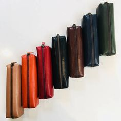 Vegetable tanned leather pencil case in Black Navy Red