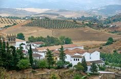Spain. So much like Greece, and yet so different. On my list of Top Ten Places I Want To Visit | Here we have a picture of the Town of Ronda, Andalusia. Read the link. The food...oh, the food....