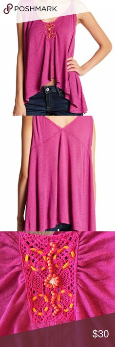 """NWT Free People New Vibes Pink Tank Top Brand new with tags, pink New Vibes tank from Free People.  This tank has asymmetrical straps and an asymmetrical hem.  The middle of the neckline has a rectangular lace patch with beaded and woven details.  The perfect casual top that can be worn with a jacket and jeans as it gets colder.  - Size Small - Approx. 21"""" long to shortest hem, 26"""" long to longest hem - 70% rayon, 30% linen  - Closet ID #0026 Free People Tops Tank Tops"""