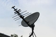 Post with 80609 views. I didn't want to pay for TV service anymore so I turned my satellite dish into a badass HDTV antenna (x-post from /r/DIY) Diy Tv Antenna, Wifi Antenna, Ham Radio Antenna, Radios, Satellite Dish, Tv Services, Electronics Projects, Gadgets, Cleaning
