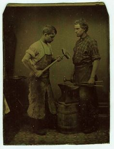 Occupation. Tintype of a master blacksmith/farrier with his apprentice and their tools.