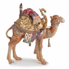 "The Nativity Standing Came is a Christmas classic! This beautiful Nativity Collection captures the true reason for the season! Our stunning ceramic Nativity Figurines create a breathtaking family holiday tradition. The Nativity Standing Camel is majestic and features a saddle with golden accents. - Stands 11"" high."