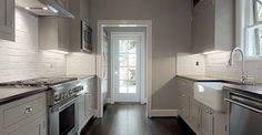 Suzie: Elizabeth Garrett Interiors - Gray kitchen with gray paint color, gray inset kitchen ...