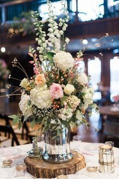 Simply Stunning Wedding Centerpieces: Gorgeous Floral Centerpiece on a Rustic Wood Slab