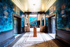 LEIGHTON HOUSE MUSEUM IN LONDON - Blue tiled interior of the so-called Narcissus Hall leading to the ebonised staircase.