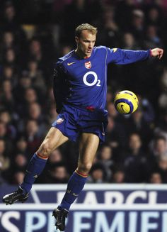 The blue away kit of Arsenal in the season 2004/2005 is as stylish as its wearer Dennis Bergkamp.