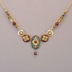 SKU: HY 13402 Created with lightweight and beautiful metals, this luxurious necklace brings you handcrafted elegance, a regal design, and memories ready to be made. Niobium, gold fill, garnet, Swarovs