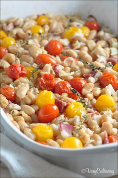 Simple baked beans with sweet cherry tomatoes, salty bacon, garlic, and Parmesan. A perfect side dish!