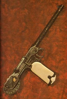 c.1893: Borchardt C-93 semi-automatic pistol, forerunner of the Luger. An ornate, Pimped Out, example with engraving, gold inlay & ivory fittings :: Original designed by Hugo Borchardt (1844–1921) in 1893.