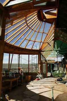 An Earthship in during construction in the Greater World Earthship Community outside Taos, New Mexico August 7, 2007...For the past 30 years eco architect Michael Reynolds has been designing Earthships-  self-sustained, off-the-grid housing constructed of recycled tires, cans, and bottles.  Reynolds regularly teaches Earthship construction to local builders in countries like Japan, France, Jamaica, and Belize as well as providing disaster relief housing solutions to disaster victims in New…