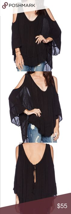 """Free People Cold Shoulder Top Soft and swingy, oversized cold shoulder tee with unfinished trims and pleating at neckline. Keyhole with tie closure at nape. Sheer.  95% Rayon 5% Spandex Hand Wash Cold Import Bust: 68.0"""" = 172.72 cm Length: 27.5"""" = 69.85 cm Sleeve Length: 11.0"""" = 27.94 cm Free People Tops Blouses"""