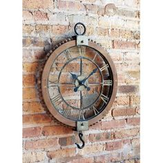 Melrose International Large vintage look clock resembles an old fashioned gear. Handsomely crafted of Roman numerals and hook. Lends a vintage vibe on a grand scale!