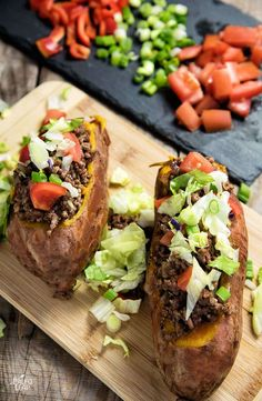 "Taco-Stuffed Sweet Potatoes. A different Paleo-friendly twist on tacos, this time served inside a ""shell"" of sweet potato."