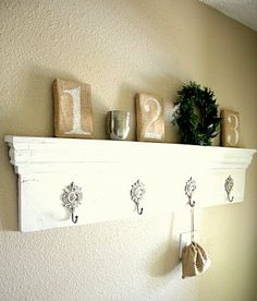 What a cute and functional wall shelf.  I shall make it and call her Shelly.