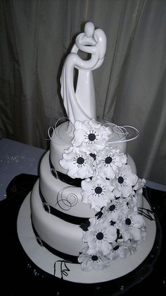 I'm not a fan of the cake topper, but I like the ribbons on each layer and the flowers