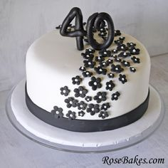 Black & White 40th BIrthday Cake with Black Flowers.  It's an elegant, yet simple cake that could be changed up to work for an anniversary, baby shower, bridal shower or wedding cake!  Click over for the details!