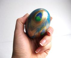 """Found this """"Peacock Feather design on duck egg"""" in a Google search; it now goes to a different Etsy peacock egg (http://www.etsy.com/listing/74864593/peacock-feather-design-on-duck-egg), so I'm linking to the original photo instead, as I prefer it. Would love to find this one."""