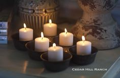Recipe for Cozy: The weather calls for a cozy home. Add some warmth with an old muffin tin and a 1/2 dozen candles.