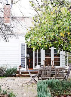 French doors open to the garden where each autumn, Liz invites friends to enjoy dishes made from the orchard's quinces Outdoor Seating, Outdoor Spaces, Outdoor Living, Ar Fresco, Estilo Country, Country Style, Weatherboard House, Outside Patio, Pergola