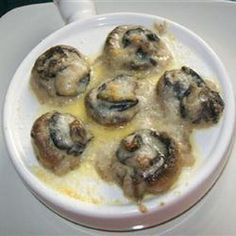 Easy Garlic Escargots Recipe Appetizers with escargot, butter, garlic, mushrooms, white wine, cream, all-purpose flour, ground black pepper, dried tarragon leaves, grated parmesan cheese