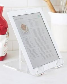 Use an inexpensive acrylic plate stand to prop up your tablet on the kitchen counter while cooking. The Container Store