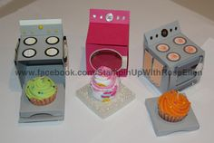 Cupcake oven (and washing machine / dryer) made with Stampin' Up! card stock .  I used cupcake shaped candles for the outside two ovens (real cupcakes will fit). And for the center washing machine / dryer  I used baby socks rolled into a cupcake shape.