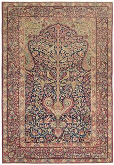 "Laver Kirman ""Tree of Life"" antique Persian rug, 3rd Quarter, 19th century. The tableau of this collectible city antique rug presents a unique heart-shaped bulb that serves as fertile ground for a ""Tree of Life,"" whose branches support winsome turtledoves and cockatoos."