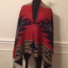 Wrap Wrap with the colors of navy, rust, and khaki. It's 100% acrylic and fastens in front. Accessories Scarves & Wraps
