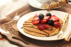 breakfast in bed pancakes with berries and chocolate drizzle served