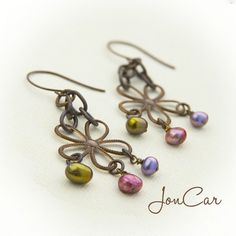 Jewel Tone Etched Floral Earrings. $24