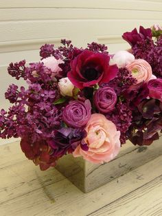 love the ranunculus and shades of purple for a fall wedding
