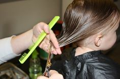 A tutorial with step by step photos showing how to cut girls hair in a simple bob with an undercut.