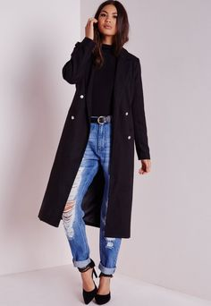 Knockout is an understatement when it comes to this black longline coat. In a fierce tailored cut this on point military vibin' coat with contrasting silver button finish is a must-have this season. Team over skinny jeans and crop to turn...